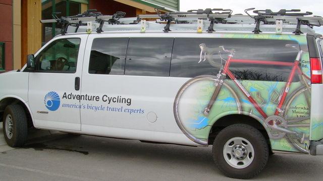 chevrolet-3500-van-with-thule-gutter-foot-rack-300-fairing-side-arm-bike-rack-594-01.jpg