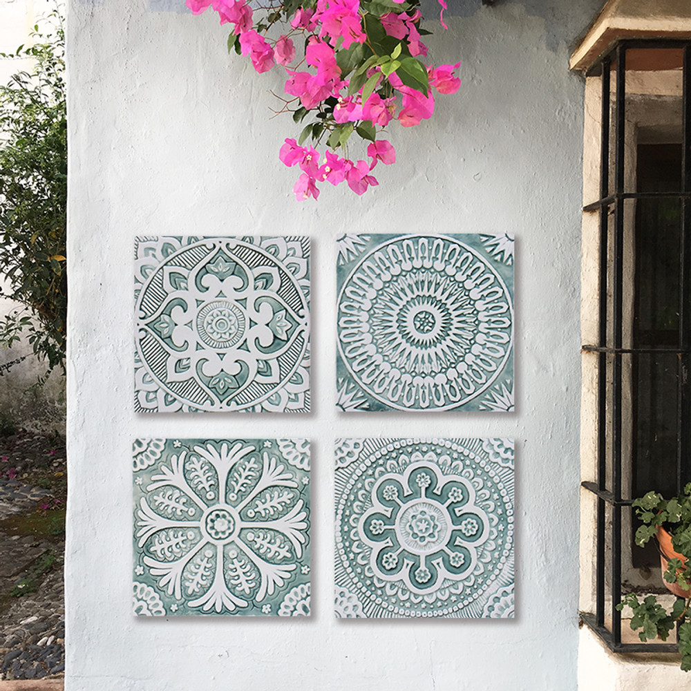 Handmade tile with carved relief for kitchens, bathrooms and outdoor wall art. Decorative tile handmade in Spain.