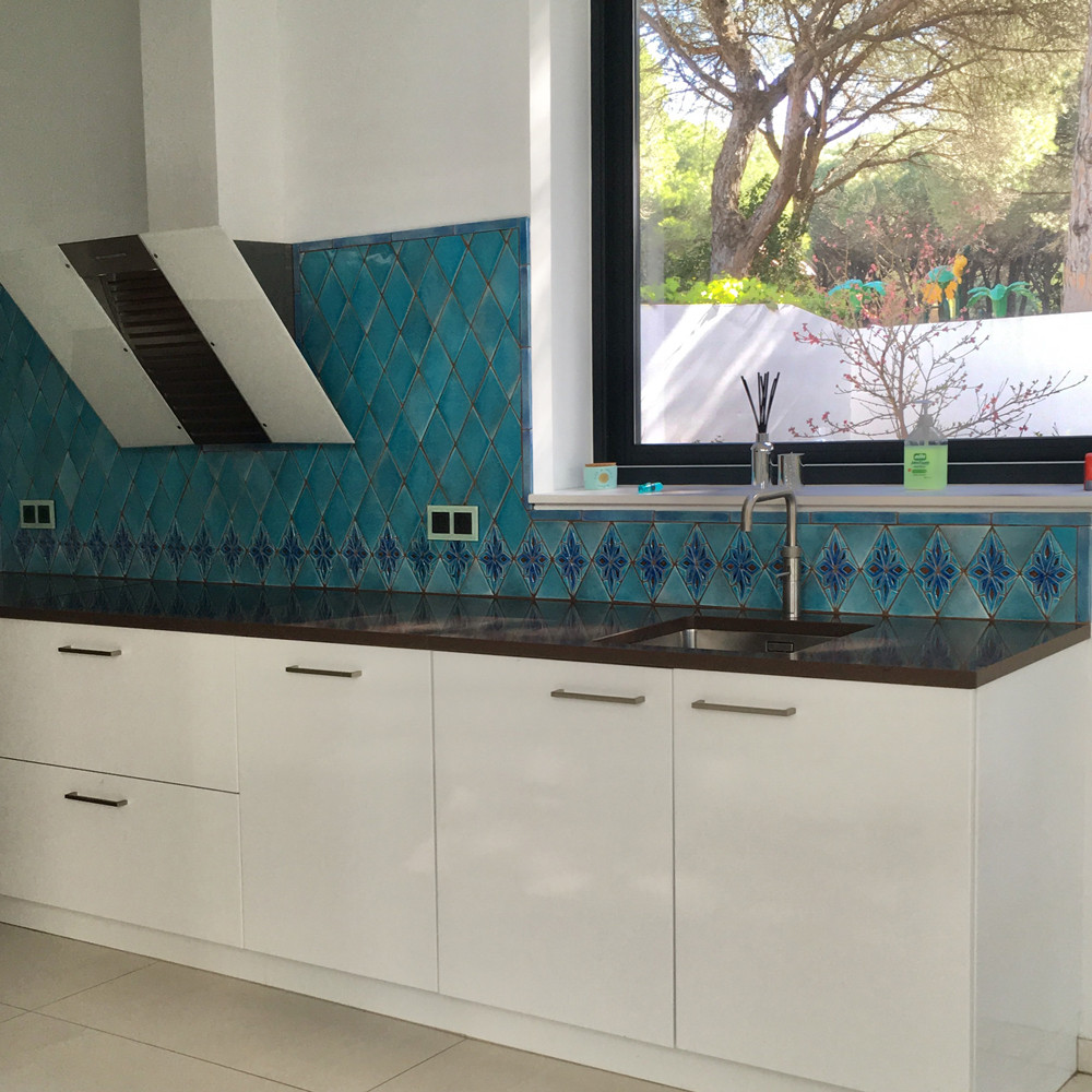 Handmade tiles Kitchen backsplash using turquoise diamond tiles and moroccan diamond tiles