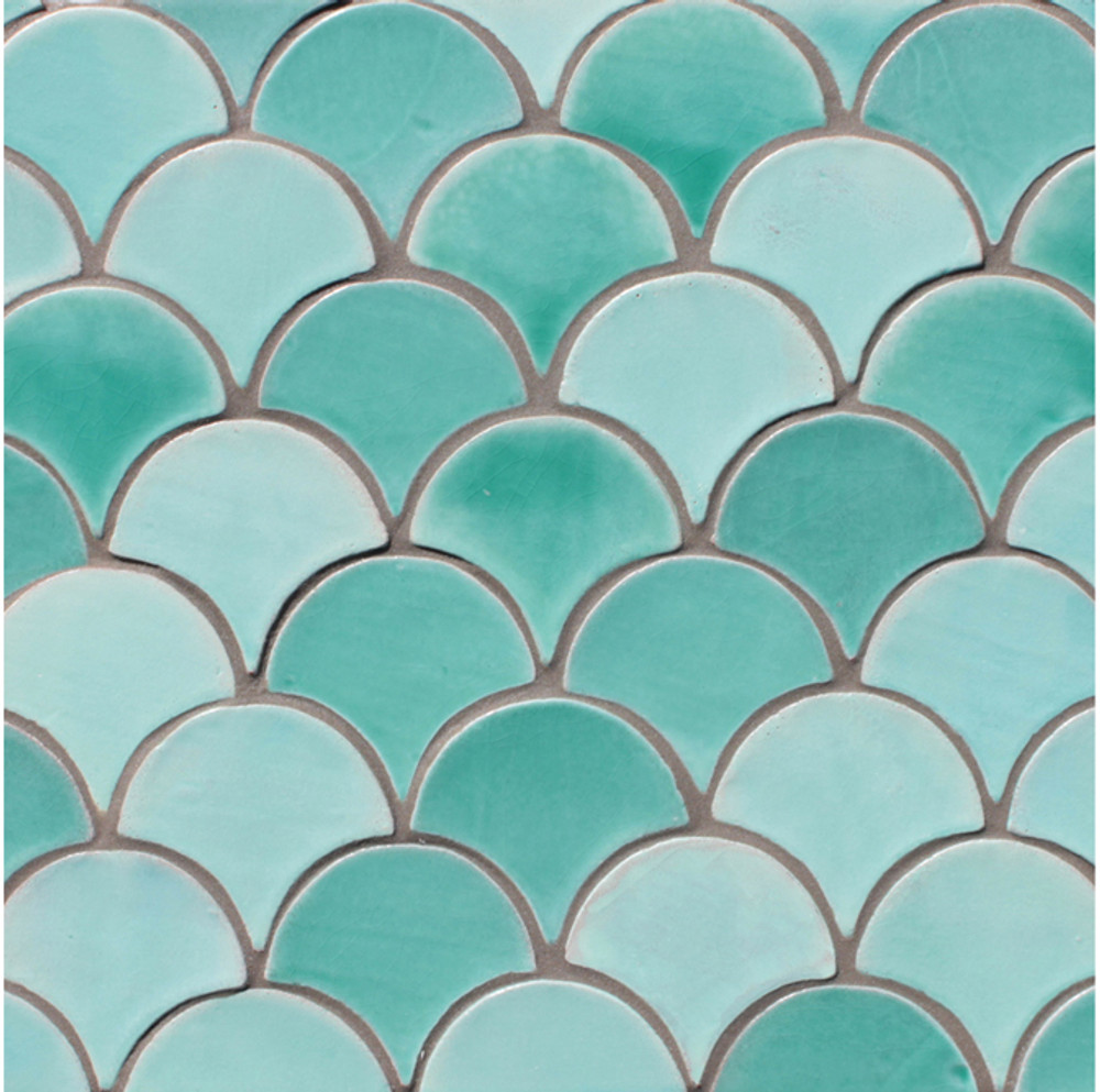 Handmade tiles in fishscale shape for kitchens and bathrooms. Handmade in Spain.