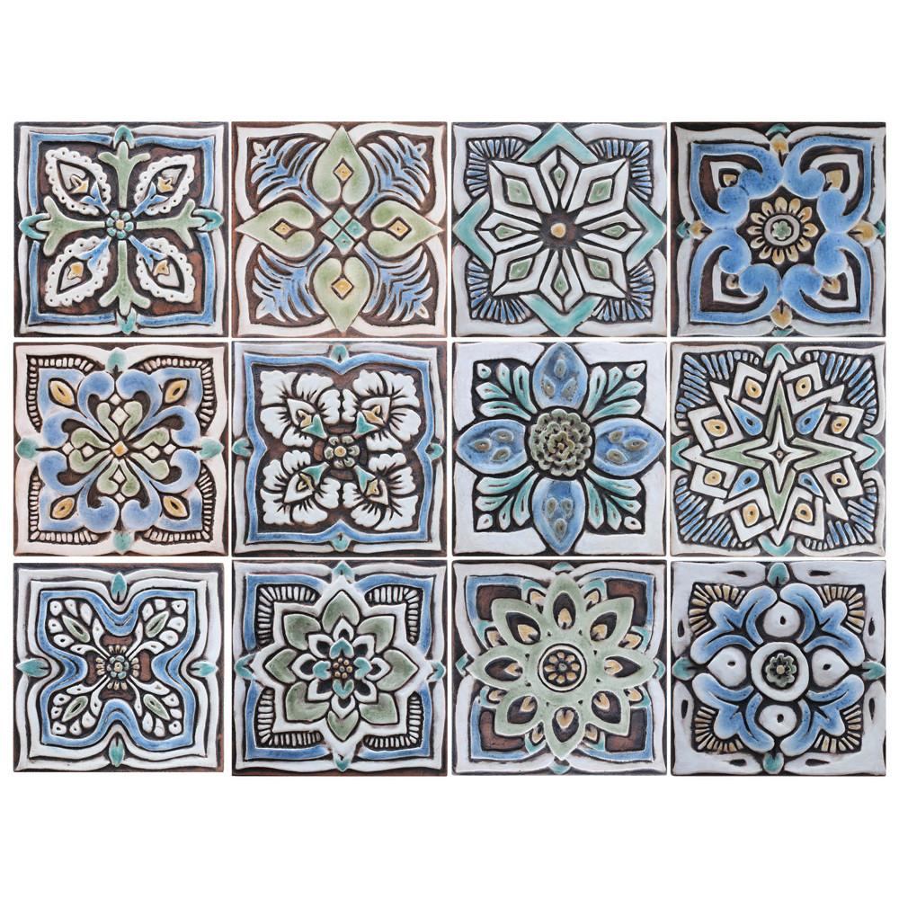 These handmade tiles make wonderful wall hangings and outdoor wall art.  Matt blue decorative tile handmade in Spain.