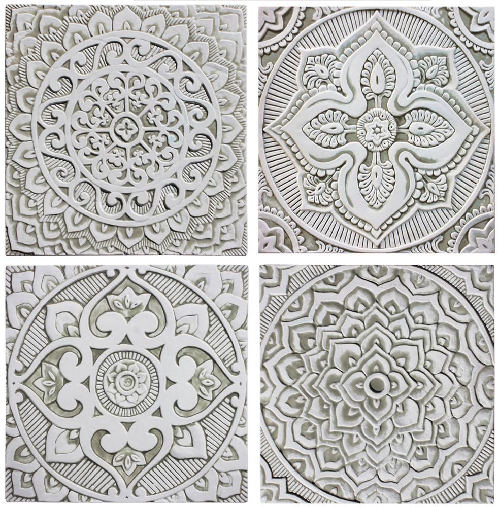 Handmade tiles with mandala design glazed in beige and white.