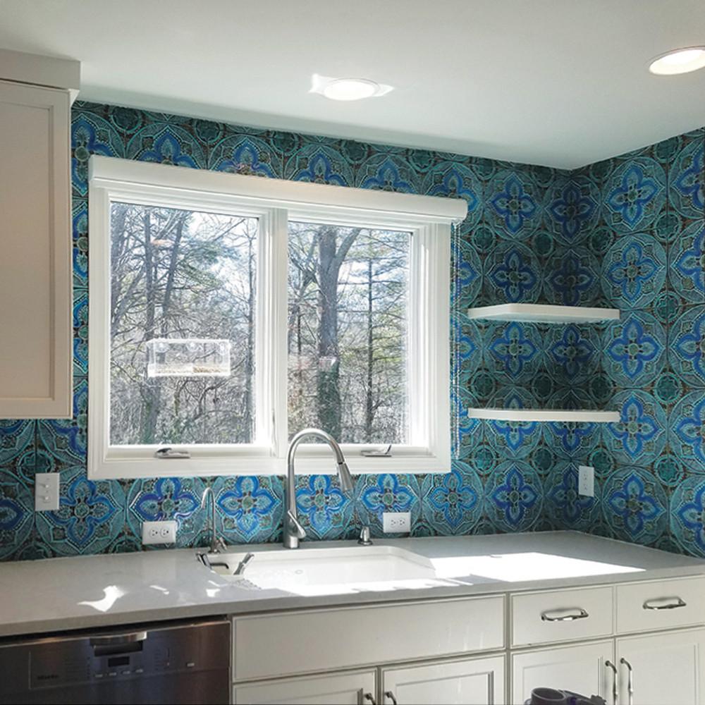Kitchen backsplash. Turquoise handmade tile with decorative relief. Large decorative tile with Moroccan design.