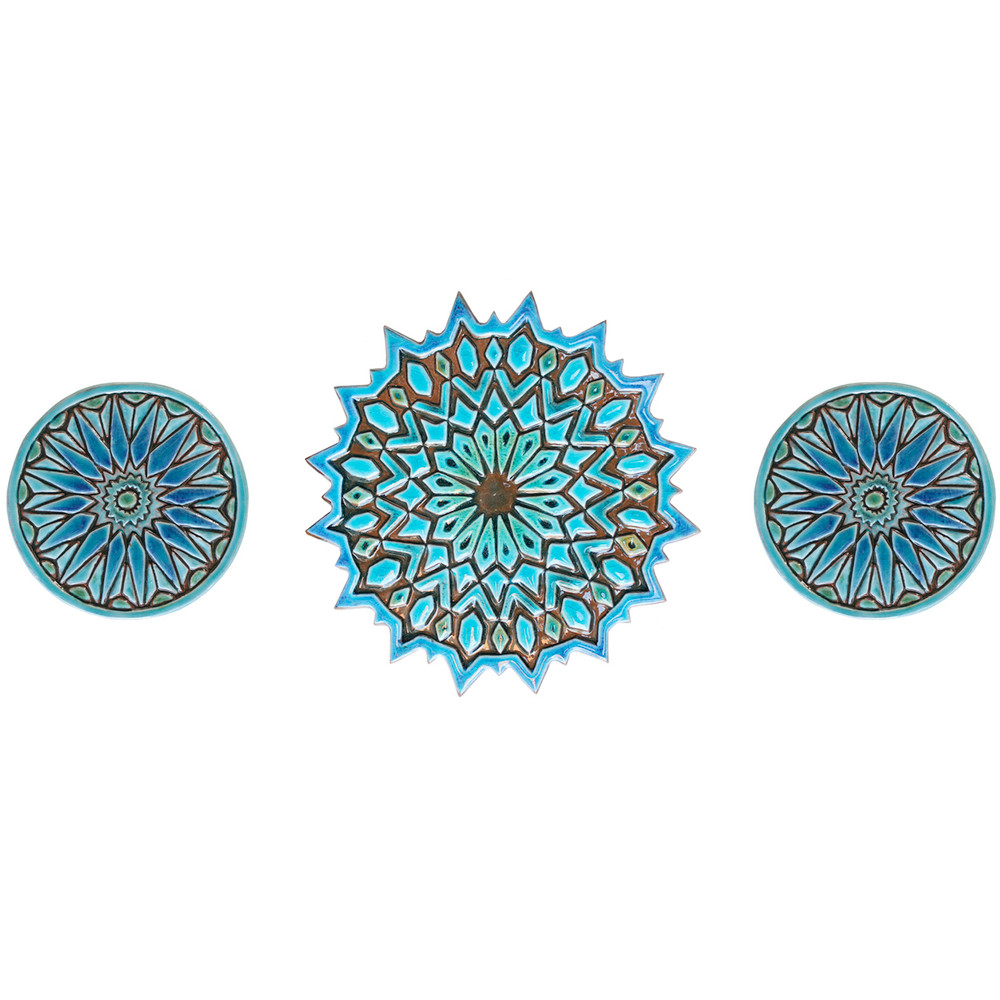 These handmade tiles glazed in turquoise make unique wall hangings for kitchens and bathrooms. Our decorative tiles make wonderful outdoor wall art.  Circle garden decor handmade in Spain.