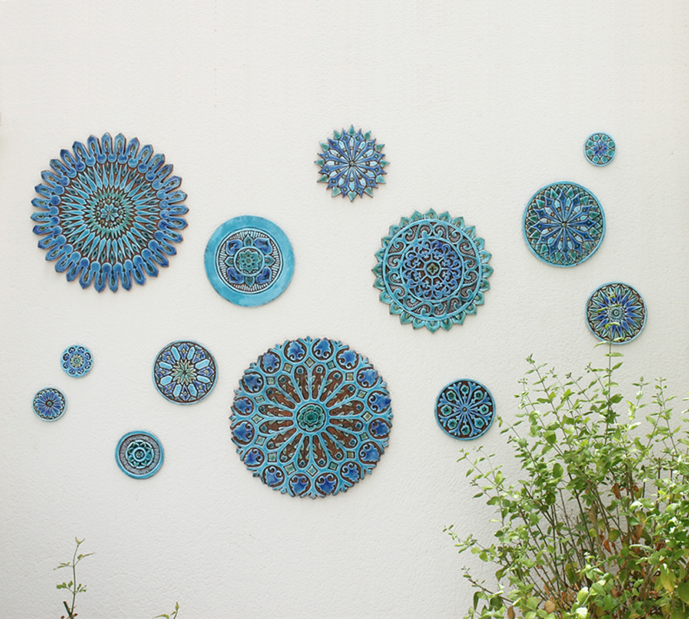These Moroccan tiles are glazed in turquoise and make unique wall hangings for kitchens and bathrooms. Our decorative tiles also make wonderful outdoor wall art.  Circle garden decor handmade in Spain.
