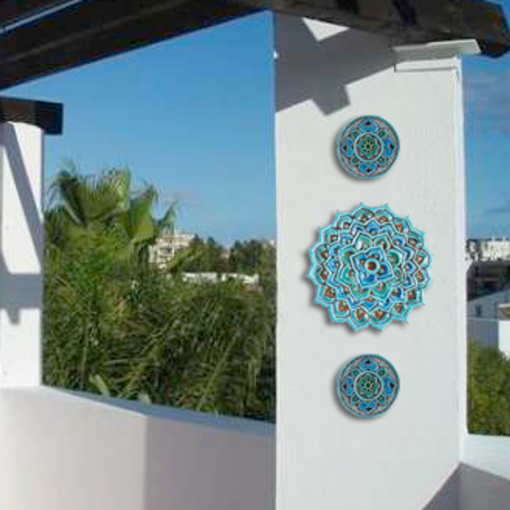 These handmade tiles make unique wall art for kitchens and bathrooms. Our decorative turquoise circle tiles make wonderful outdoor wall art, perfect for garden or terrace walls.