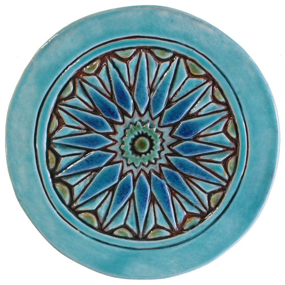 These turquoise handmade tiles make unique wall hangings for kitchens, bathrooms or outdoor wall art. Our decorative tiles can also be combined with our many other circular tiles to make larger wall art installations.