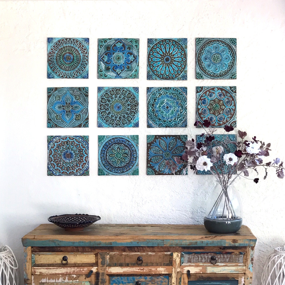 Turquoise handmade tile with decorative relief. Large decorative tiles handmade in Spain.