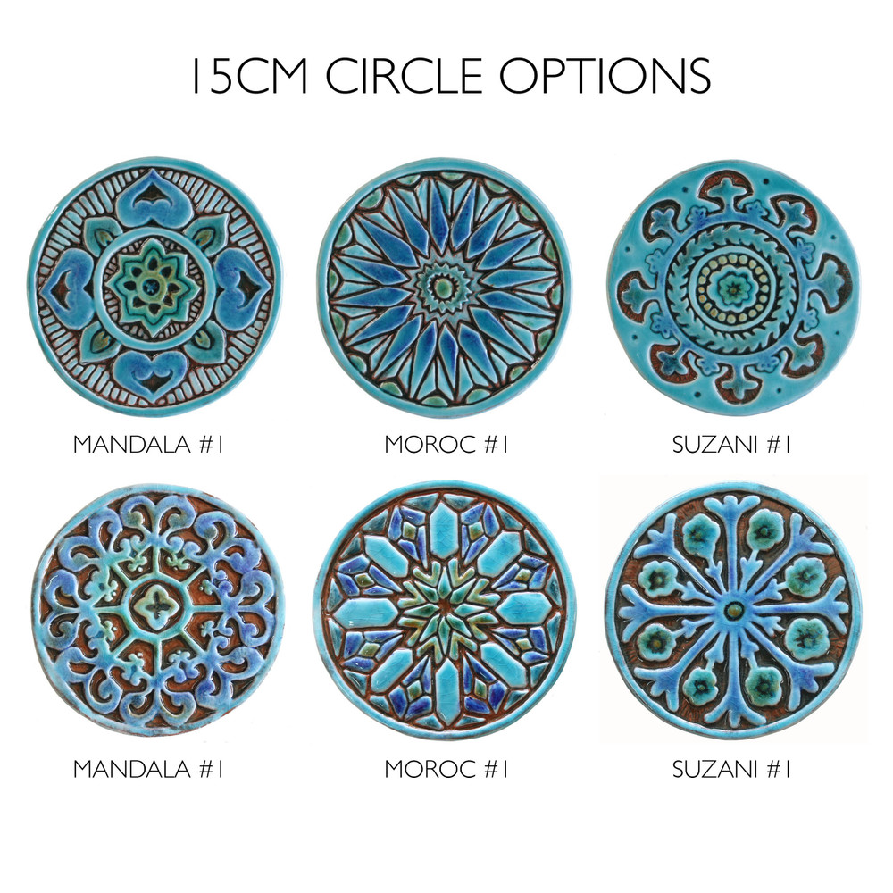 These handmade tiles make a unique wall art installation.  Our decorative tiles make wonderful outdoor wall art, either on a garden column or home entrance. Turquoise circle garden decor handmade in Spain.