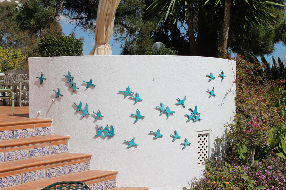 Create your unique wall art installation with these turquoise abstract flying birds. Ceramic wall art for kitchens, bathrooms and outdoor wall decor. Our handmade tiles make a beautiful wall art installations.