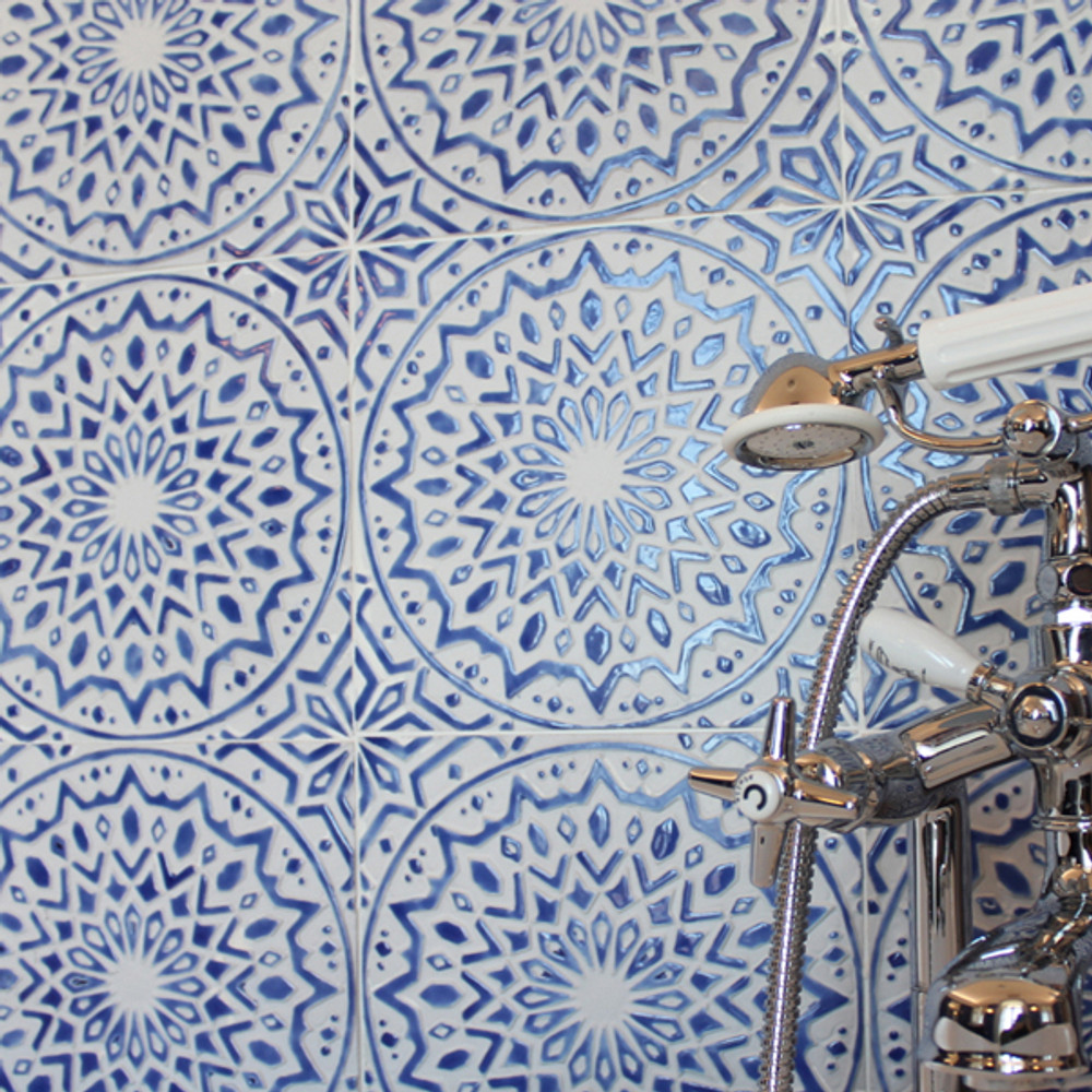 Luxury bathroom with blue and white handmade tile with relief. Decorative tile handmade in Spain.