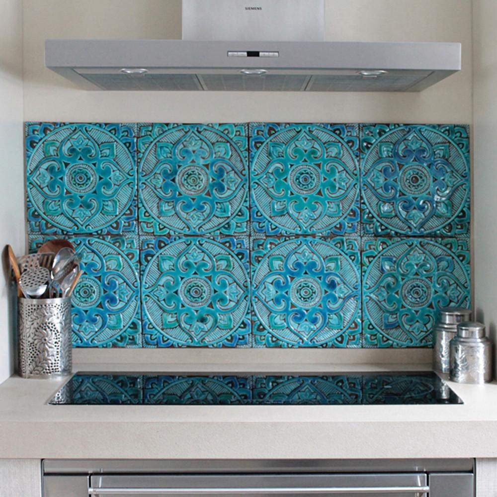 Kitchen backsplash. Turquoise handmade tile with decorative relief. Large decorative tile with mandala design.