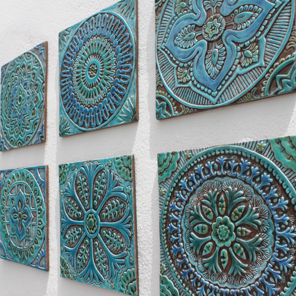Outdoor wall art. Turquoise handmade tile with decorative relief. Large decorative tile with mandala design.