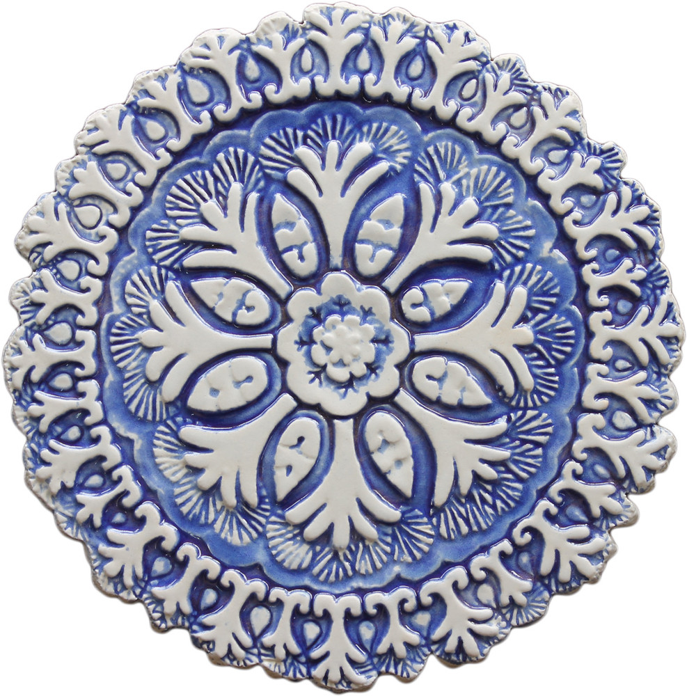 These circular tiles make beautiful outdoor wall art and unique wall hangings for kitchens and bathrooms. Our decorative tiles can also be combined with our other handmade tiles to make larger wall art installations.