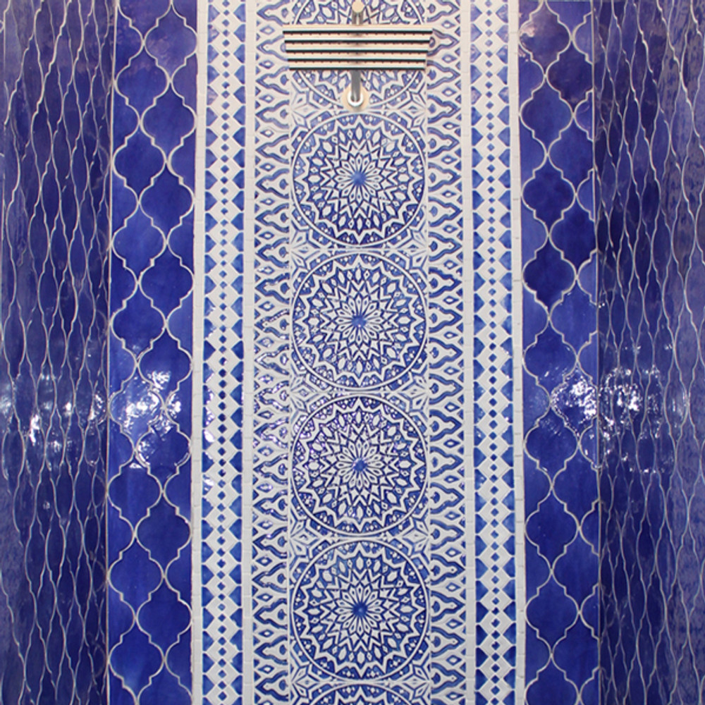Handmade tile for kitchens, bathrooms and outdoor wall art. Decorative tile handmade in Spain. Relief tile glazed in blue and white.