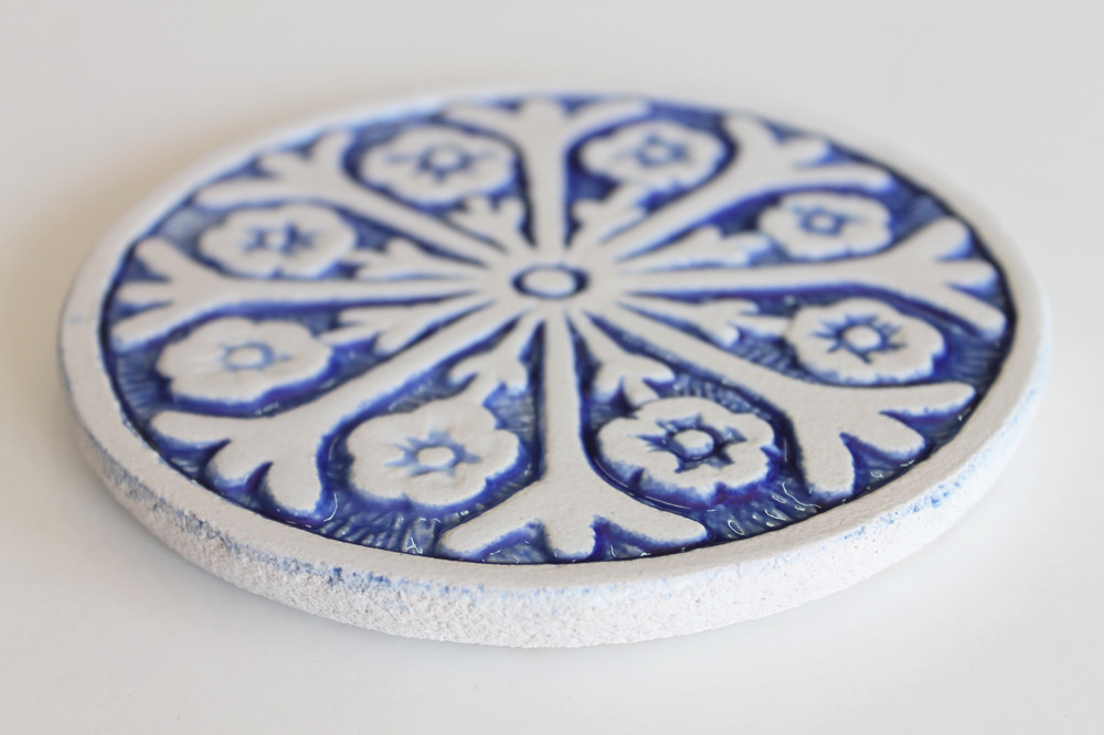 These circular tiles make beautiful outdoor wall art.  Blue and white wall hangings for kitchens, bathrooms and wall decor. Our decorative tiles can also be combined with our other handmade tiles to make larger wall art installations.