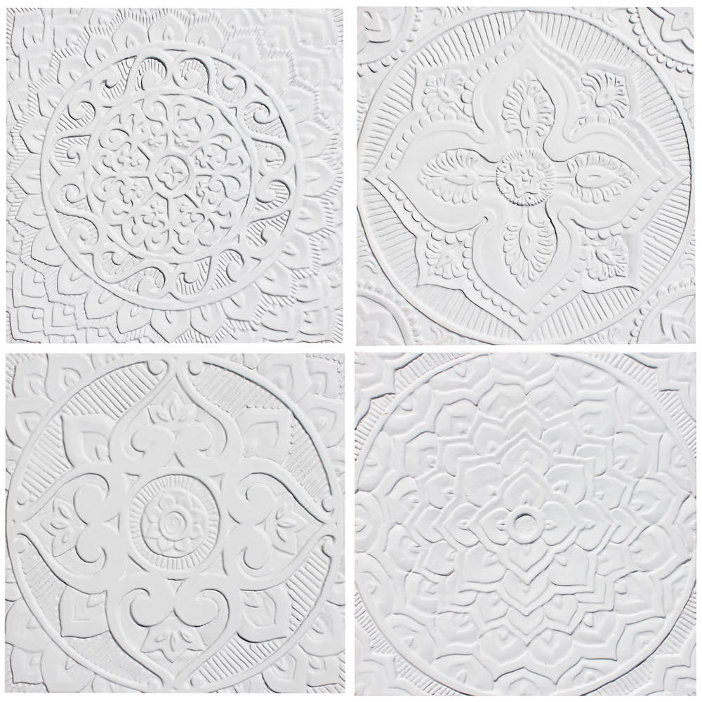 These handmade tiles are for kitchens and bathrooms.  These decorative tiles also make wonderful wall hangings and outdoor wall art.  Our white relief tiles are handmade in Spain.