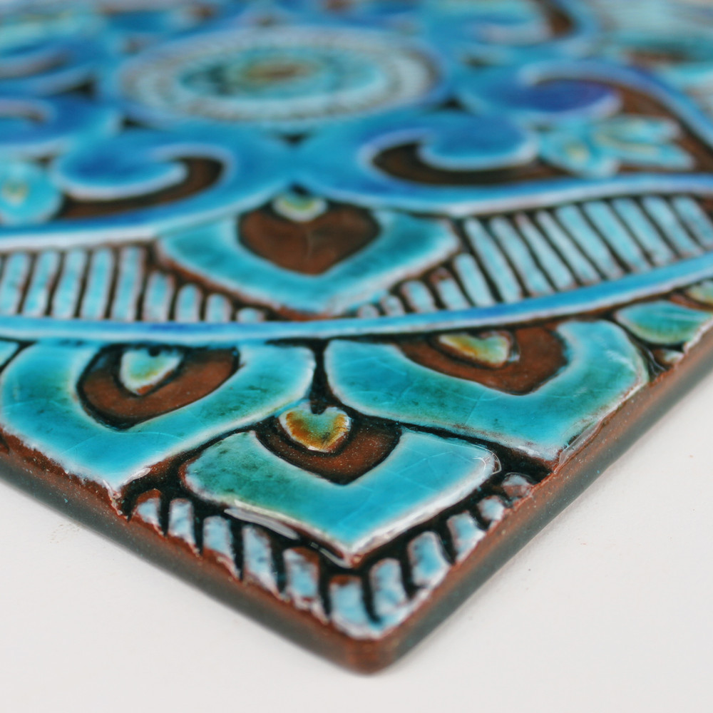 Turquoise handmade tile with decorative relief. Large decorative tile with Mandala design.