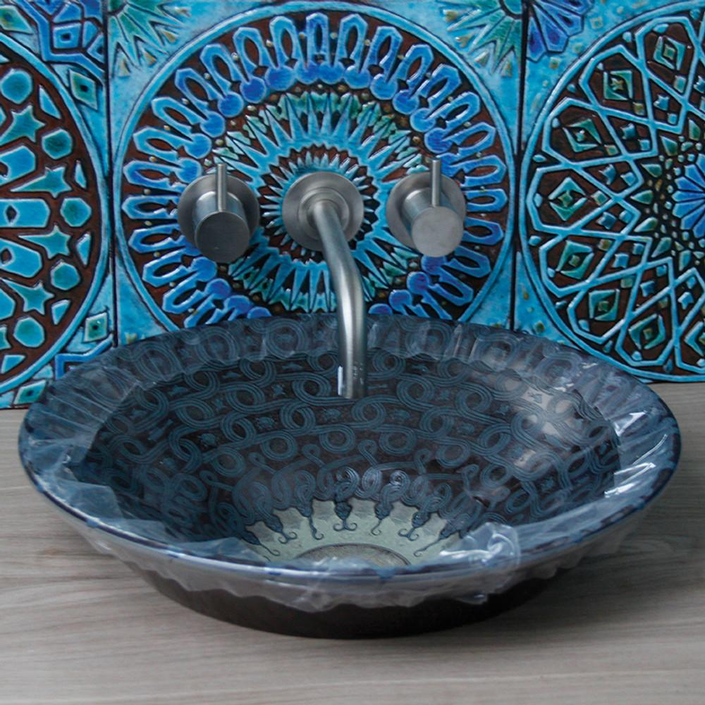 Kitchen backsplash. Turquoise handmade tile with decorative relief. Large decorative tile with Suzani design.