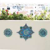 Ceramic wall art installation with Handmade tiles.  Decorative tiles used as outdoor wall art.  Spanish tile wall decor.