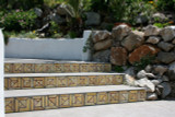 Custom handmade tiles to decorate exterior steps or risers with abstract design.