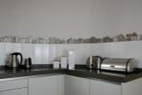 Kitchen backsplash using handmade tiles by GVega.  Handmade in Spain.