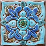 Turquoise handmade tile with suzani  decorative relief. Decorative tile handmade in Spain.