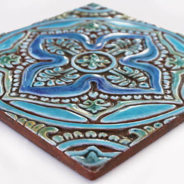 Turquoise handmade tile with decorative relief. Decorative tile handmade in Spain.