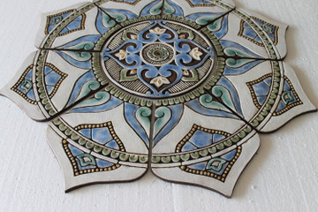 Our ceramic murals make unique outdoor wall art for your garden or patio walls. Our decorative tiles are handmade in Spain.