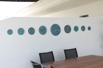 These circular tiles make beautiful outdoor wall art.  Ceramic wall art for kitchens, bathrooms and wall decor. Our decorative tiles can also be combined with our other handmade tiles to make larger wall art installations.