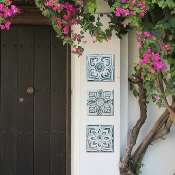 Handmade tile for kitchens, bathrooms and outdoor wall art. Decorative tile handmade in Spain in aqua & white.