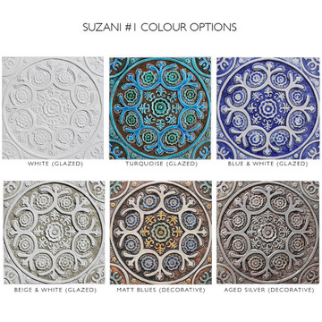 Turquoise handmade tile with decorative relief. Large decorative tile with Suzani design.