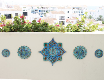 These circular handmade tiles make unique wall hangings for kitchens, bathrooms or outdoor wall art. Our turquoise decorative tiles can also be combined with our many other circular tiles to make larger wall art installations.
