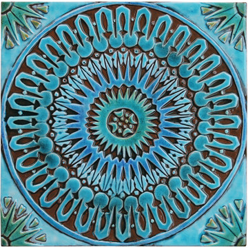 Turquoise handmade tile with decorative relief. Large decorative tile with Moroccan design.