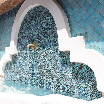 Ceramic fountain. Turquoise handmade tile with decorative relief. Large decorative tile with Moroccan design.