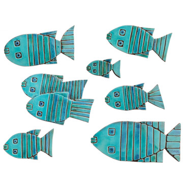 Turquoise handmade tile ceramic fish wall art installation. Handmade in Spain.