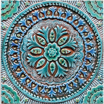 Turquoise tile with decorative Suzani relief. Large decorative tiles handmade in Spain.