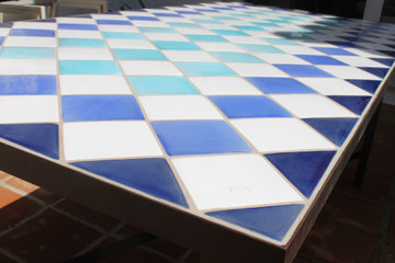 Mosaic table made from Handmade tiles.  Custom designed ceramic table, handmade in Spain.