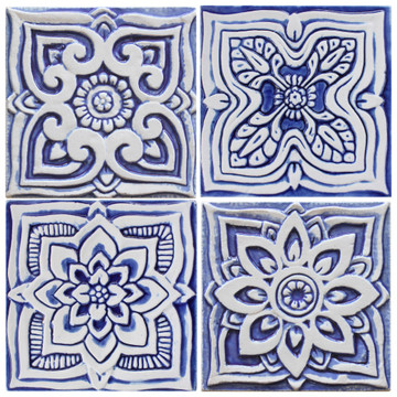 Blue and white handmade tile with relief for kitchens, bathrooms and outdoor wall art. Decorative tile handmade in Spain.