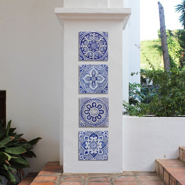 Outdoor wall art with blue and white handmade tile with relief. Decorative tile handmade in Spain.