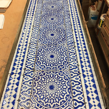 Blue and white handmade tile with relief. Decorative tile handmade in Spain.
