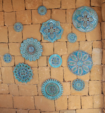 Circular Tiles Wall Art on a Stone Wall