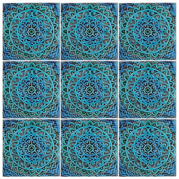 Turquoise handmade tile with decorative relief. Large decorative tile with Mandala design. Pattern.