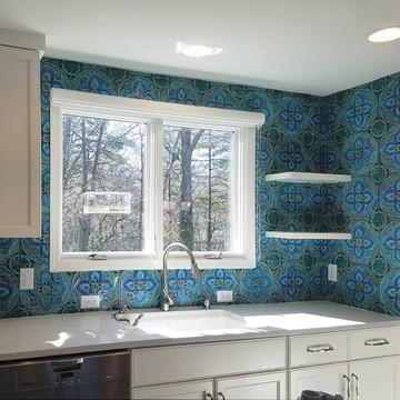 Kitchen backsplash.Turquoise handmade tile with decorative relief. Large decorative tile with Suzani design.