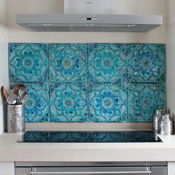 Kitchen backsplash. Turquoise handmade tile with decorative relief. Large decorative tile with Suzani design.