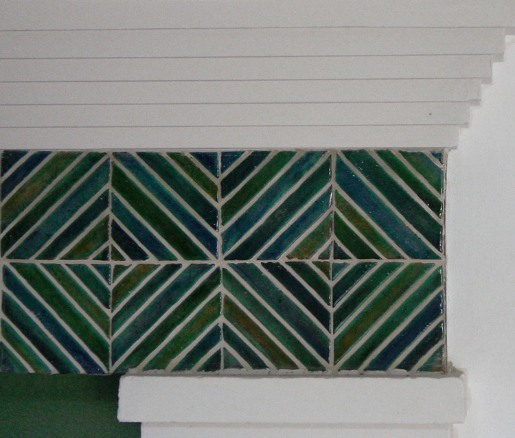 Handmade ceramic turquoise tile - architectural feature on lift entrance.