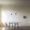 String Lights Black Matte Finish pendant light hanging over a dining table in