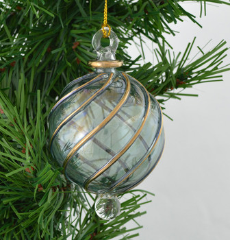 Green Round with Gold Swirl Mouth Blown Egyptian Glass Ornament on greenery