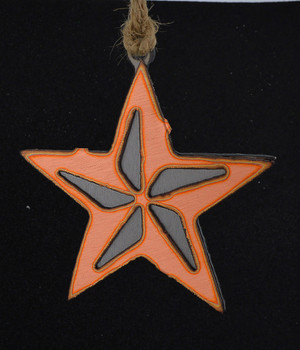 Lone Star Copper Ornament on surface balck background