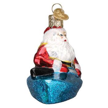 Santa In Kayak Glass Ornament Ornament side